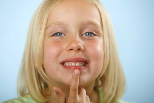 Girl touching lip
