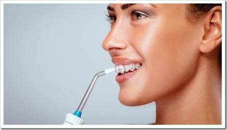 Зачем использовать ирригатор, когда есть зубная нить?